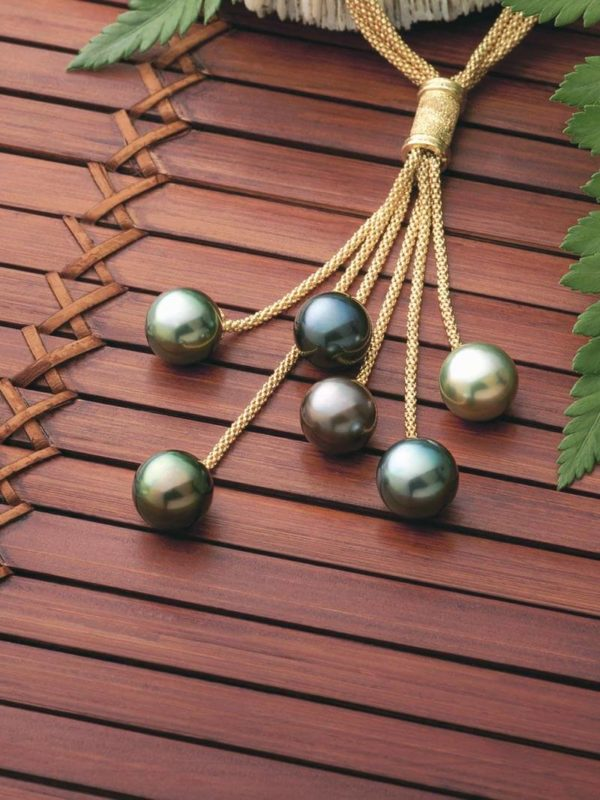 18Kt yellow gold necklace holding six multi-hued Tahitian Pearls immerses the wearer in its beauty
